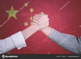 Successful Business Team With China Flag Stock Photo