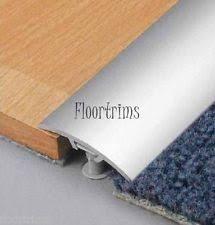 carpet joint strip. aluminium door bar threshold strip transition in silver laminate to carpet tiles joint