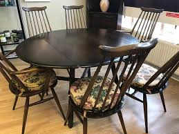 lovely ercol dining table and six ercol chairs with original seat pads