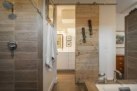 ... Sliding barn door saves up space in the small contemporary bathroom  [From: Lucy Call