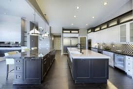transitional kitchen with two islands with black cabinetain white cabinets agatha black granite and