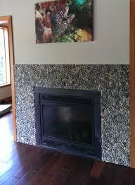 bali ocean pebble tile fireplace surround