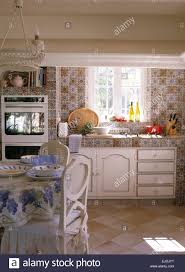 Patterned Tiles For Kitchen Patterned Wall Tiles And Worktop In French Country Kitchen With