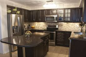 kitchens with dark cabinets. Fine Cabinets Cozy Kitchen Is Stuffed With Dark Wood Cabinetry Brushed Metal  Hardware Black Marble Countertops And Patterned Tile Backsplash Plus Aluminum  With Kitchens Dark Cabinets K