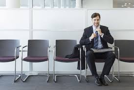 interview questions about why you want to change jobs man waiting in office lobby for job interview