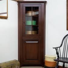 small corner cabinet with glass door