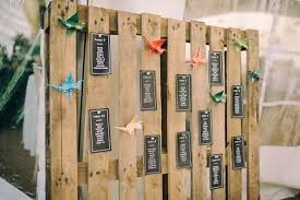 wedding table chart. wooden pallet seating chart with modern signage wedding table