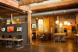 cool office spaces. Adorable Creative Interior Office Space Design With Some Hardwood F Tables Brown Leather Sofas Fireplace Black Swivel Chair Hi Cool Spaces E