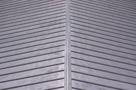 step 1 secure the corrugated metal roof panels