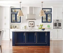 white kitchen with a custom blue kitchen island