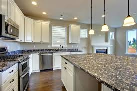 Kitchen Built In Stove On Island And Sleek Brown Wooden Laminate Countertop  Polished Chrome Semi Flush · Kitchen Modern White Cabinets ...
