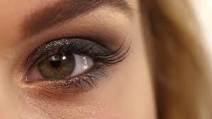 eye makeup woman applying eyeshadow powder beautiful woman face perfect makeup beauty fashion eyelashes cosmetic eyeshadow close up slow motion