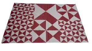 red geometric rug hook props