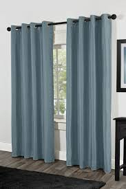 engaging window treatment decoration with single dark brown metal curtain rod including grommet top slate blue curtain and all white interior wall paint