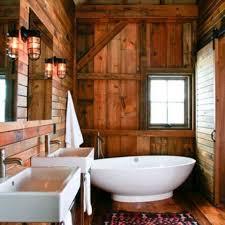 rustic bathroom. pleasant wall lamps beside simple mirror above white sink near egg bathtub on wooden floor inside rustic bathroom