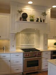 Old World Kitchen Design With Standard Tiles Installed Diagonally With  Accent Deails Makes This Kitchen Backslash