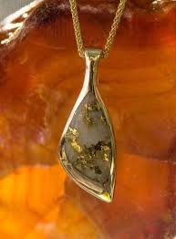cly gold quartz pendant with unique cut that displays the natural gold veins visit us at goldrushfinejewelry