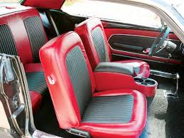 in 1965 the mustang s interior was considered well equipped standard equipment included gauges a sporty three spoke steering wheel and carpet in a time