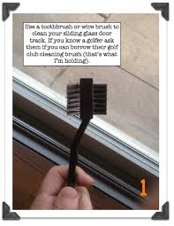 scrub the shower track thoroughly with an old toothbrush after soaking with undiluted vinegar or bleaching agent for an appreciable amount of time