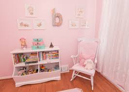 white wooden rocking chair. Casual Pink Themed Room With White Wooden Bookshelf Also Rocking Chair For Your Baby Nursery N