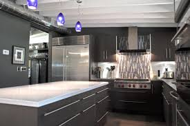 cool industrial kitchen with matte black appliance and mosaic tiles