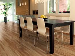 best luxury vinyl wood plank flooring for modern minimalist kitchen and dining room design with black wood dining table and 6 white chairs with stainless