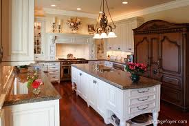 cherry hardwood flooring contrasting white cabinetry multi colored marble countertops and large stainless steel appliances