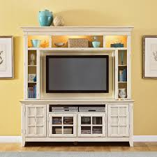 high white wooden tv stand with small shelves around the tv space combined with storage plus