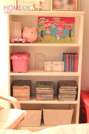 Definitely adding a reading nook to Q's Big Boy Bedroom. -- Perfect Reading  Nook: Organizing your child's bookshelf.