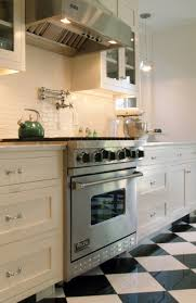 Small white kitchens with white appliances Pure White Architectural Digest Black And White Kitchen Backsplash Tile Home Design And Decor