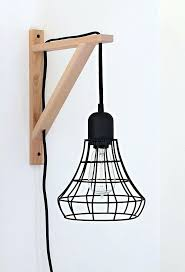 swag lamps that plug in ikea cage light sconce a clever idea using the threshold industrial swag lamps that plug in ikea