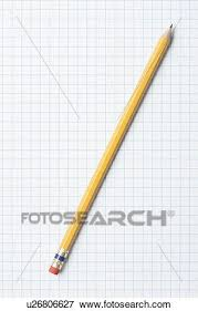 Single Yellow Sharpened Pencil On Graph Paper Stock Photo