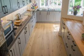 laminate flooring vs wood with kitchen tile effect engineered floors in and ideas how to install