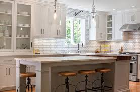 apothecary style cabinets in a white modern kitchen with vintage chairs apothecary furniture collection