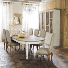 traditional dining room lighting fixture with crystal chandelier over oval wooden dining table and grey replaceable upholstered dining chairs also classic