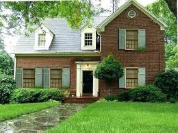 cream brick house houses with brick red brick house black door cream trim light blue shutters