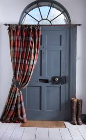 the perfect addition to a country home doorway a thermal wool door curtain complete with leather tieback farrow ball down pipe grey painted door