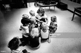 Toddle-In North Nursery Children Crowd By Teacher The teacher, Noreen...  News Photo - Getty Images