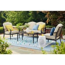 Home depot patio furniture Small Space Laurel Oaks 4piece Patio Conversation Set With Putty Cushions The Home Depot Metal Outdoor Lounge Furniture Patio Furniture The Home Depot