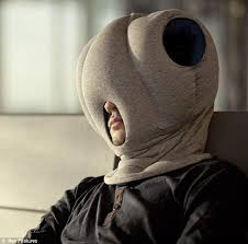 office sleeping pillow. burying their head in the sand inventor is offering a solution for resting on office sleeping pillow