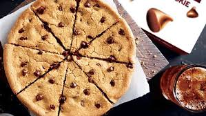 pizza hut chocolate chip cookie. Modren Chip The Ultimate Hersheyu0027s Chocolate Chip Cookie Is An Oversized Chocchip  Biscuit Sliced And Packaged To Resemble A Pizza Despite Lessthanstellar Reviews  With Pizza Hut H