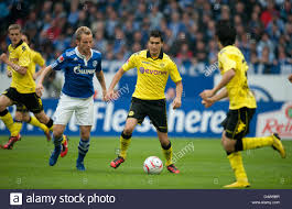 Dortmunds's Nuri Sahin (R) and Schalke's Ivan Rakitic fight for the Stock  Photo - Alamy