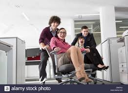 office furniture women. Office Workers Pushing Women On Chairs D9KPGJ Office Furniture Women D