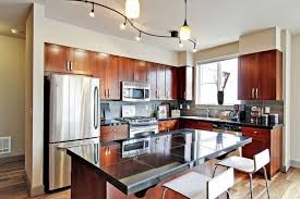 decorations vintage glossy wooden kitchen set with dark granite countertops plus white chairs also undulating