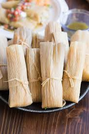 mexican food tamales.  Tamales Several Mexican Tamales Wrapped In Corn Husks With Food