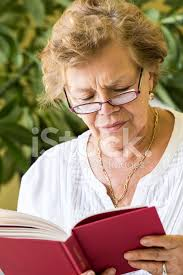 old lady reading a book