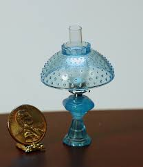 oil lamp with hobnail shade in ice blue