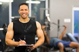 gym instructor portrait of happy male gym instructor stock photo picture and