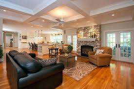 architectural ceiling river rock fireplace with traditional flush and wood coffered stained tufted area rugs