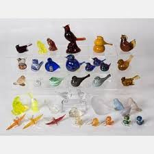 A Collection Of Colored And Clear Glass Bird Figurines